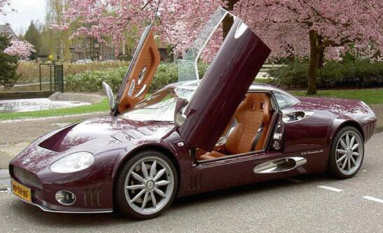 Spyker C8 Long Wheelbase with faux riveted body panels and extended wheel arches.